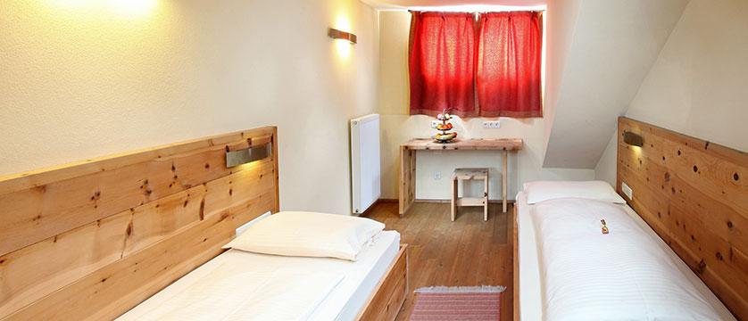 Hotel Tyrol & Alpenhof, Seefeld, Austria - Twin bedroom interior.jpg